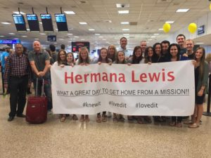 The sign we made for her at the airport and the friends gathered to greet her.